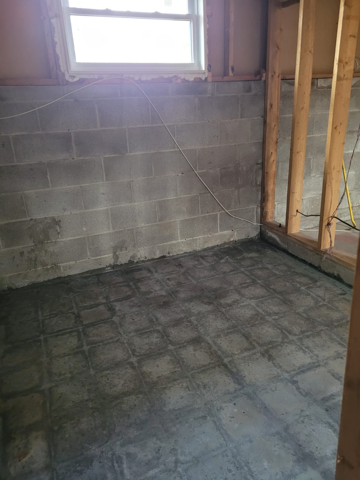 Removal of asbestos containing mastic adhesive from concrete floor (After Photo)