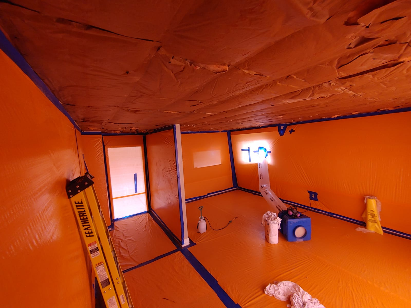 Removal of asbestos containing texture and drywall ceiling udner type III enclosure in a residence in Gerorgetown, ON
